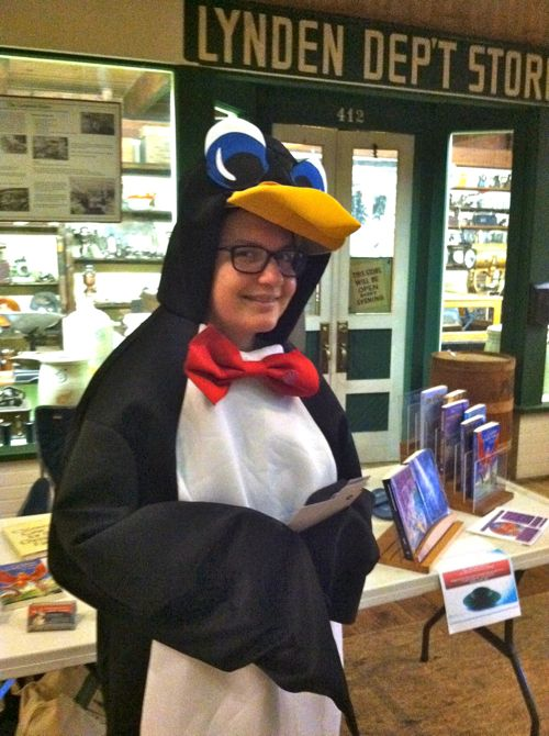 a penguin peruses Purtill's prose